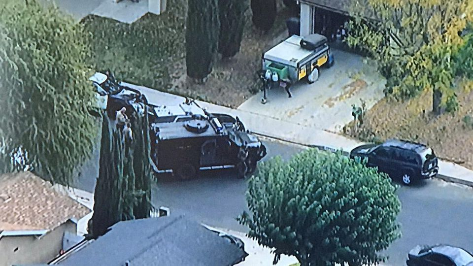 Los Angeles County Sheriff's Department (LASD) Special Enforcement Bureau (SEB) members arrive at a nearby residence, following up on leads regarding the possible suspect involved in the Saugus High School shooting in Santa Clarita, California, U.S.,