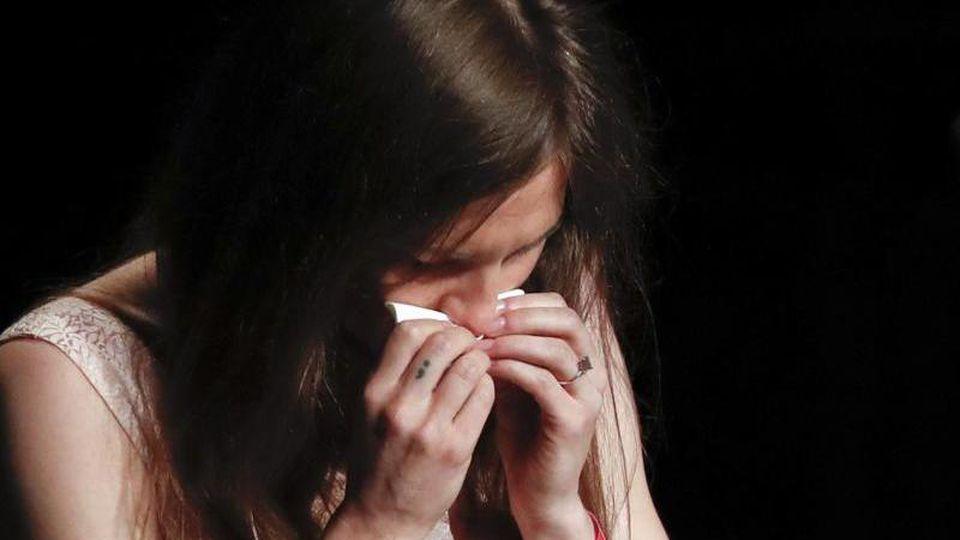 Immer wieder kämpft Amanda Knox bei dem Kongress zu Justizirrtümern mit den Tränen. Foto: Antonio Calanni/AP