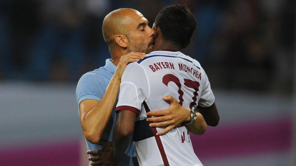 26.07.2014 Telekom Cup in Hamburg / FC Bayern München - Borussia Mönchengladbach / Trainer Pep Guardiola (FCB) und Davi