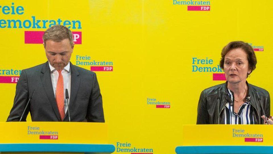 Gesenkte Köpfe: FDP-Chef Christian Lindner und die Hamburger Spitzenkandidatin Anna von Treuenfels-Frowein. Foto: Christophe Gateau/dpa