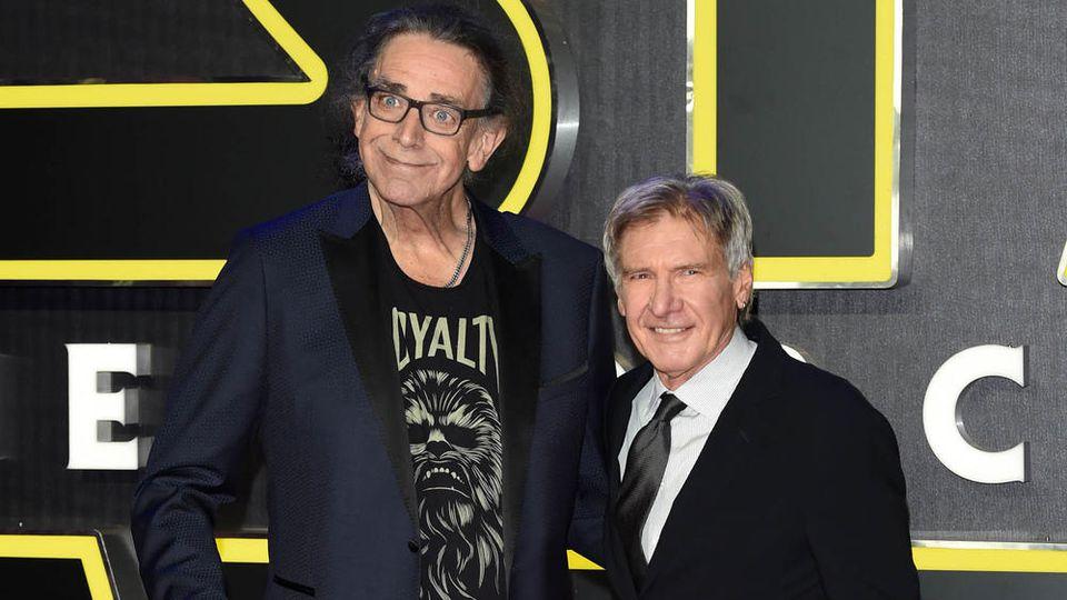 """Kämpfte sich für """"Star Wars: Das Erwachen der Macht"""" aus dem Rollstuhl zurück: Peter Mayhew (l.) mit Harrison Ford"""
