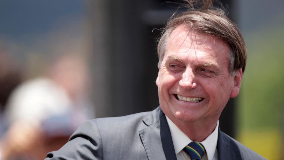 FILE PHOTO: Brazil's President Jair Bolsonaro, smiles after a Flag Day ceremony at the Alvorada Palace, in Brasilia