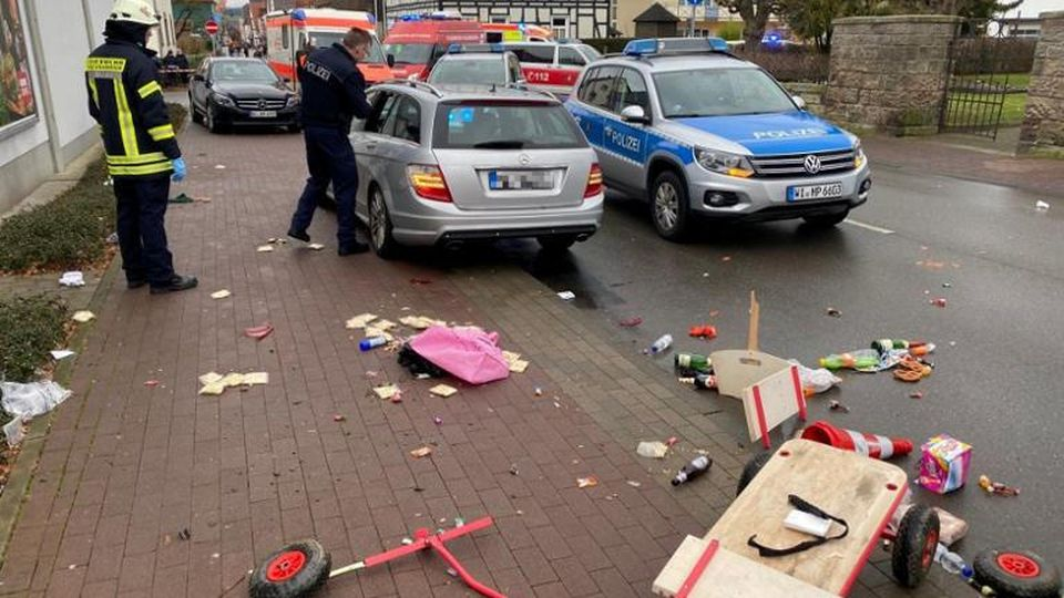 People react at the scene after a car ploughed into a carnival parade injuring several people in Volkmarsen