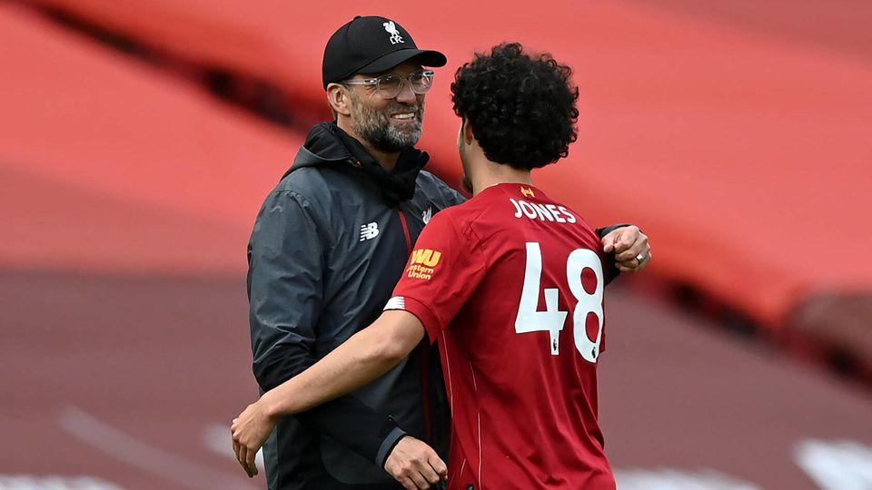 Liverpool v Aston Villa - Premier League - Anfield Liverpool manager Jurgen Klopp (left) with embraces Curtis Jones afte