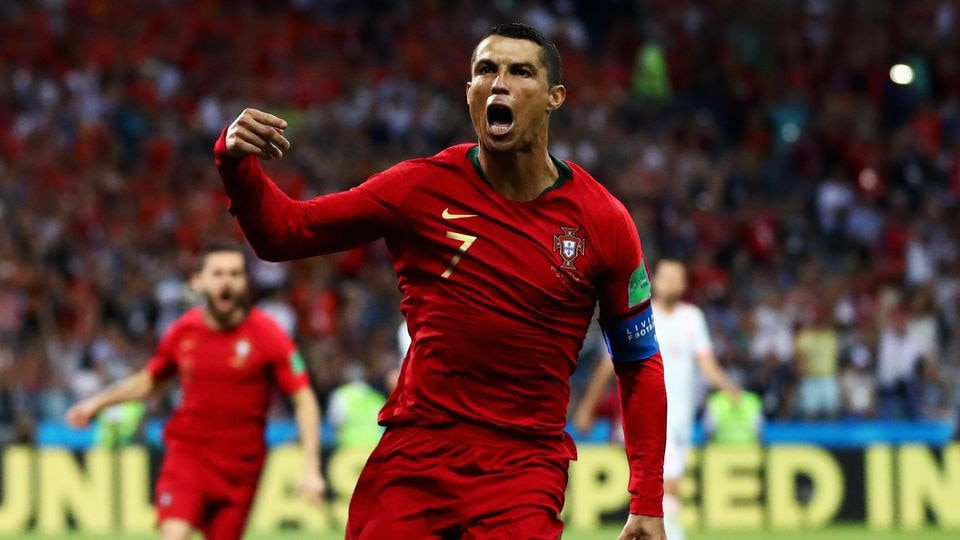 SOCHI, RUSSIA - JUNE 15:  Cristiano Ronaldo of Portugal celebrates after scoring his team's first goal during the 2018 FIFA World Cup Russia group B match between Portugal and Spain at Fisht Stadium on June 15, 2018 in Sochi, Russia.  (Photo by Dean