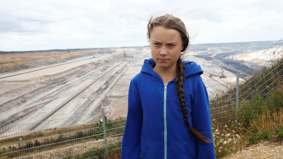 """Greta Thunberg, Swedish """"Fridays for Future"""" climate activist, stands at the edge of the Hambach open-cast brown coal mine of German utility RWE, west of Cologne, Germany, August 10, 2019.   REUTERS/Wolfgang Rattay"""