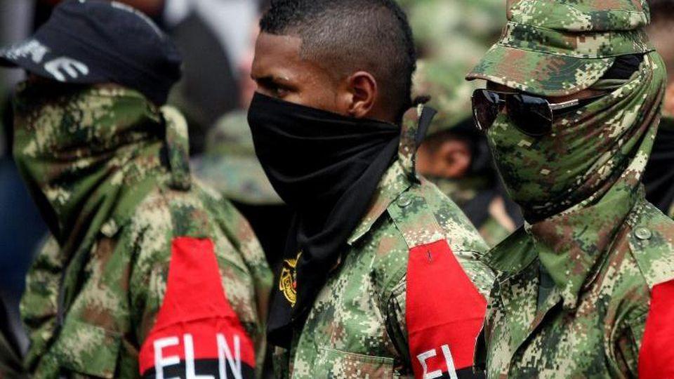 Rebellen der kolumbianischen Guerillagruppe ELN. Foto: Christian Escobar Mora/EFE/dpa/Archiv
