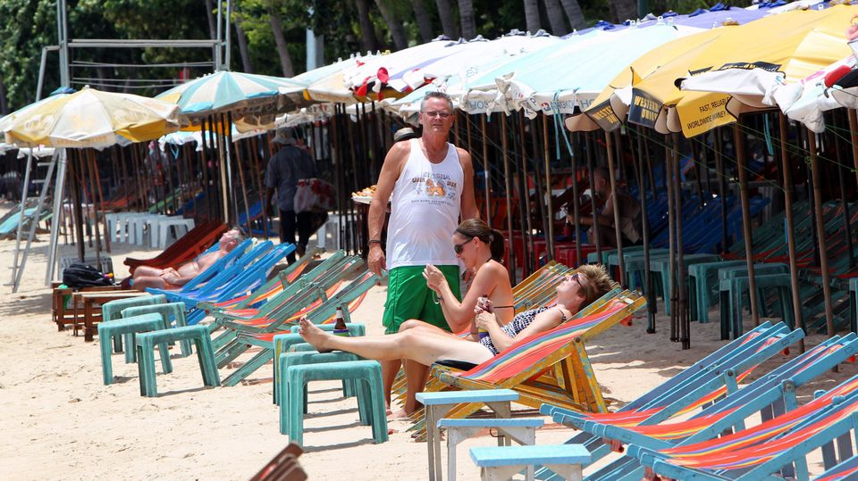 A photo made available on 02 August 2010 shows western tourists taking a sunbath on a beach at Pattaya resort city, Chonburi province, Thailand, 30 July 2010. Thailand's tourism recovery will be delayed further to the second half of 2011 due to the t