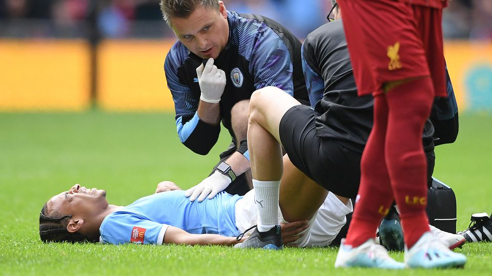 LONDON, ENGLAND - AUGUST 04: Leroy Sane of Manchester City receives medical attention during the FA Community Shield match between Liverpool and Manchester City at Wembley Stadium on August 04, 2019 in London, England. (Photo by Michael Regan/Getty I