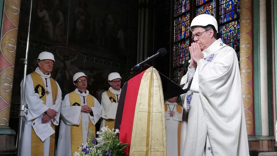 The Archbishop of Paris Michel Aupetit leads the first mass in a side chapel two months to the day after a devastating fire engulfed the Notre-Dame de Paris cathedral, in Paris