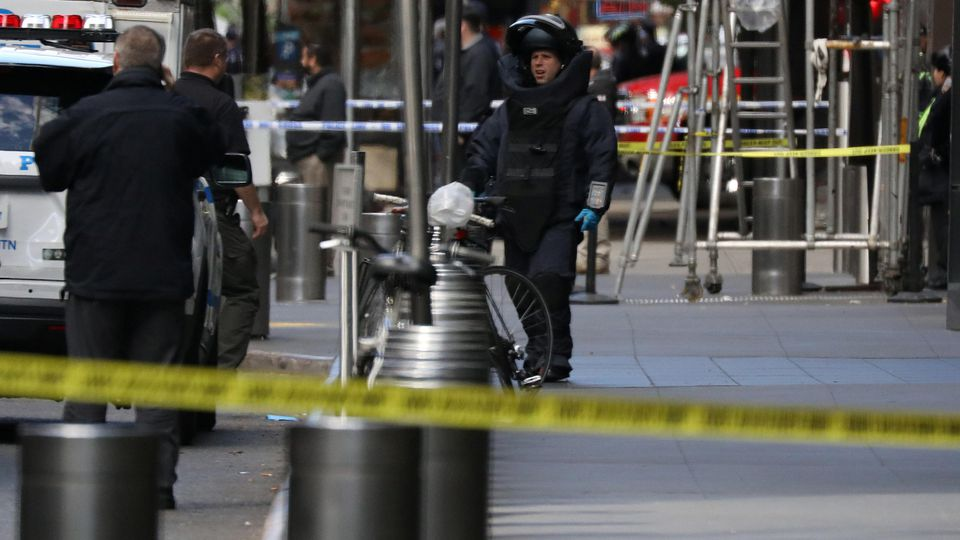 A member of the New York Police Department bomb squad is pictured outside the Time Warner Center in the Manahattan borough of New York City after a suspicious package was found inside the CNN Headquarters in New York, U.S., October 24, 2018. REUTERS/