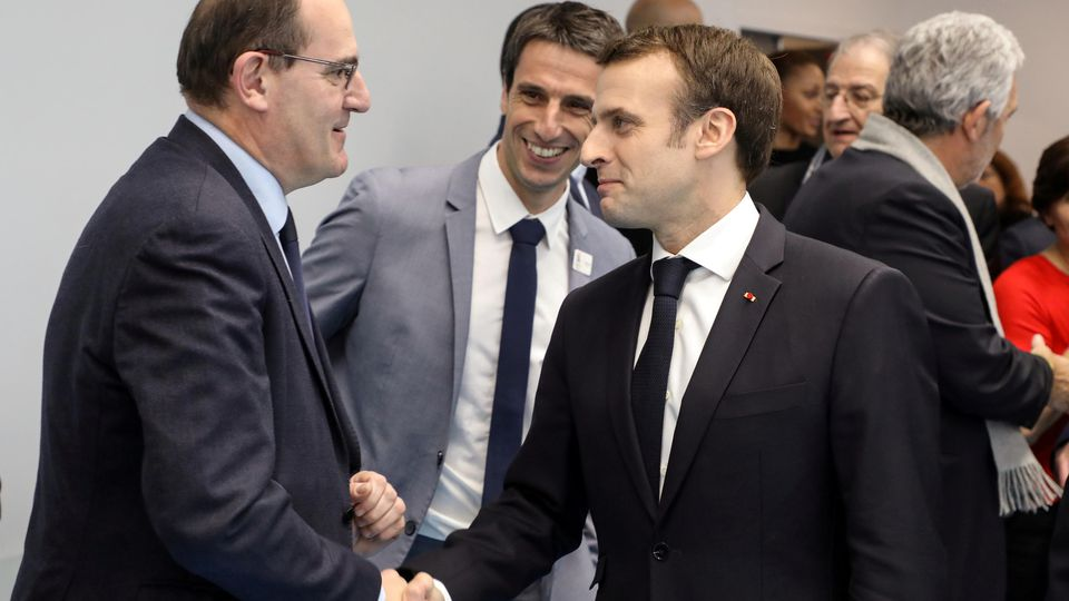 FILE PHOTO: French President Emmanuel Macron shakes hands with Interministerial Delegate for the Olympic and Paralympic Games 2024 Jean Castex flanked by President of the Paris Organising Committee of the 2024 Olympic and Paralympic Games Tony Estanguet i
