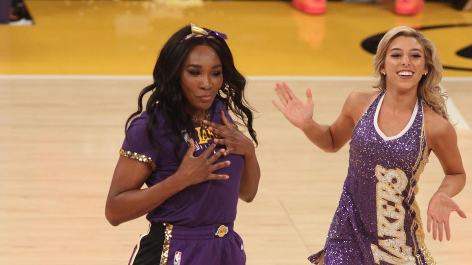 Venus Williams performs with the Laker Girls during halftime at the  basketball game between the Los Angeles Lakers and the Oklahoma City Thunder at Staples Center on November 19, 2019 in Los Angeles, California
