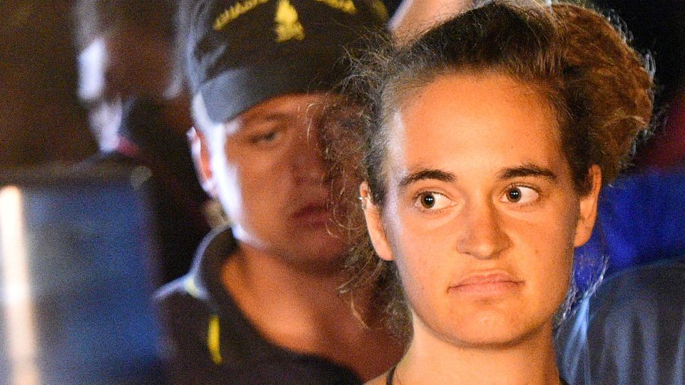 FILE PHOTO: Sea-Watch 3 captain Carola Rackete is escorted off the ship by police and taken away for questioning, in Lampedusa