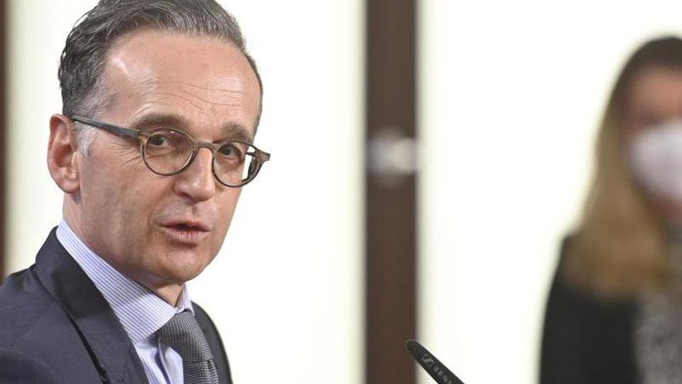 Bundesaußenminister Heiko Maas (l). Foto: John Macdougall/AFP-Pool/dpa/Archivbild
