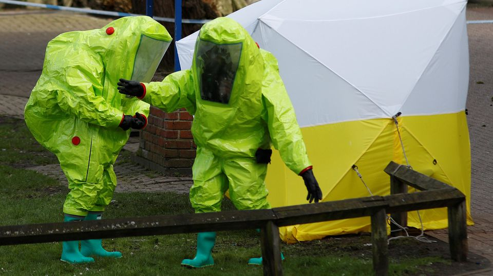 The forensic tent, covering the bench where Sergei Skripal and his daughter Yulia were found, is repositioned by officials in protective suits in the centre of Salisbury, Britain, March 8, 2018. REUTERS/Peter Nicholls