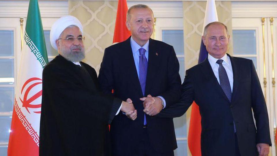 Irans Präsident Ruhani neben Gastgeber Erdogan und seinem russischenAmtskollegen Putin. Foto: arman/Iranian Presidency