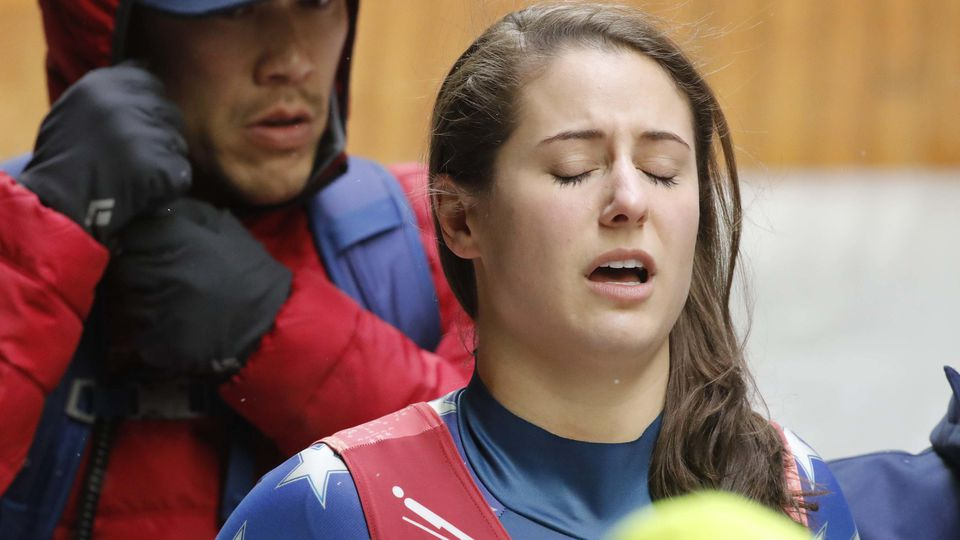 Luge - Pyeongchang 2018 Winter Olympics - Women's Singles competition - Olympic Sliding Centre - Pyeongchang, South Korea - February 13, 2018 - Emily Sweeney of the U.S. reacts after crashing. REUTERS/Arnd Wiegmann