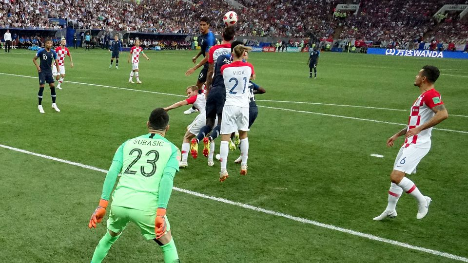 MOSCOW, RUSSIA - JULY 15:  Mario Mandzukic of Croatia scores an own goal from Antoine Griezmann of France's free-kick for France's first goal during the 2018 FIFA World Cup Final between France and Croatia at Luzhniki Stadium on July 15, 2018 in Mosc