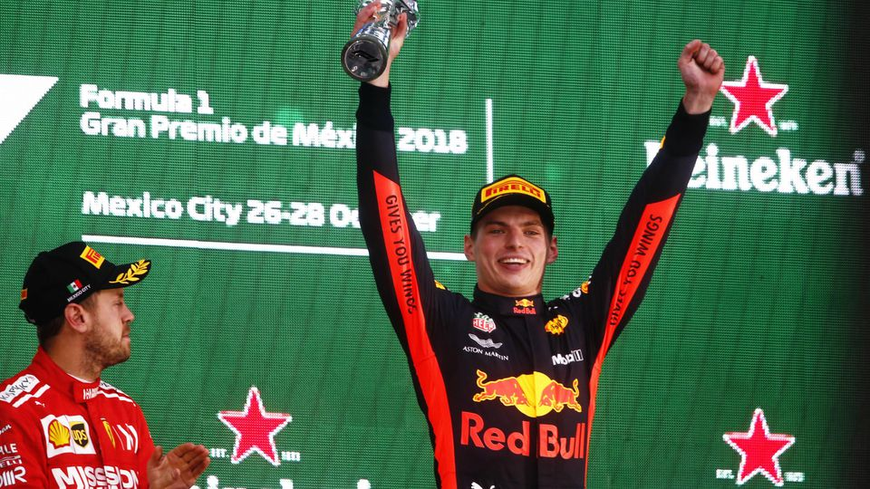 2018 Mexican GP AUTODROMO HERMANOS RODRIGUEZ, MEXICO - OCTOBER 28: Winner Max Verstappen, Red Bull Racing, celebrates on the podium with Sebastian Vettel, Ferrari during the Mexican GP at Autodromo Hermanos Rodriguez on October 28, 2018 in Autodromo