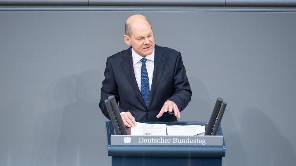 Olaf Scholz (SPD), Bundesfinanzminister, spricht. Foto: Christophe Gateau/dpa/Archivbild