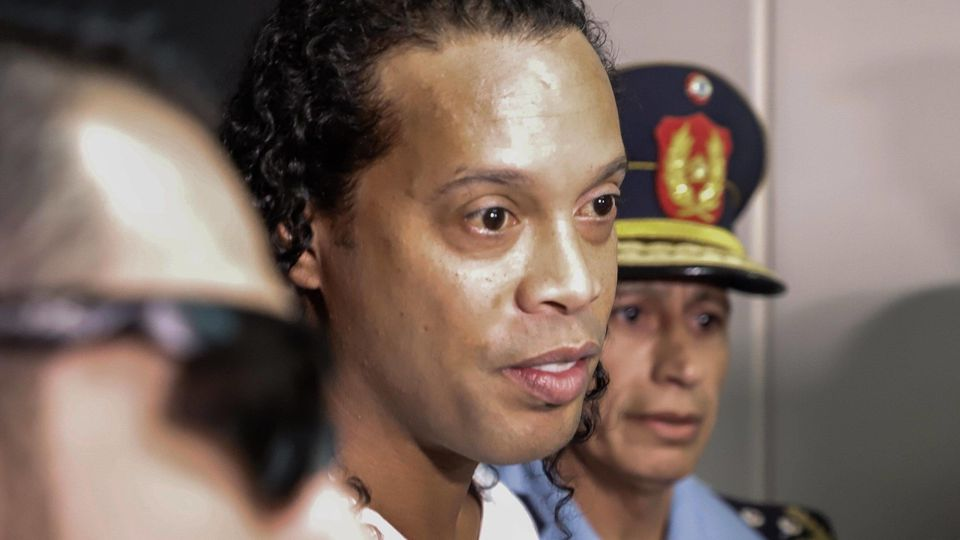 Ronaldo de Assis Moreira, Ronaldinho, arrives at the Palace of Justice to appear before Judge Mirko Valinotti, in Asunc