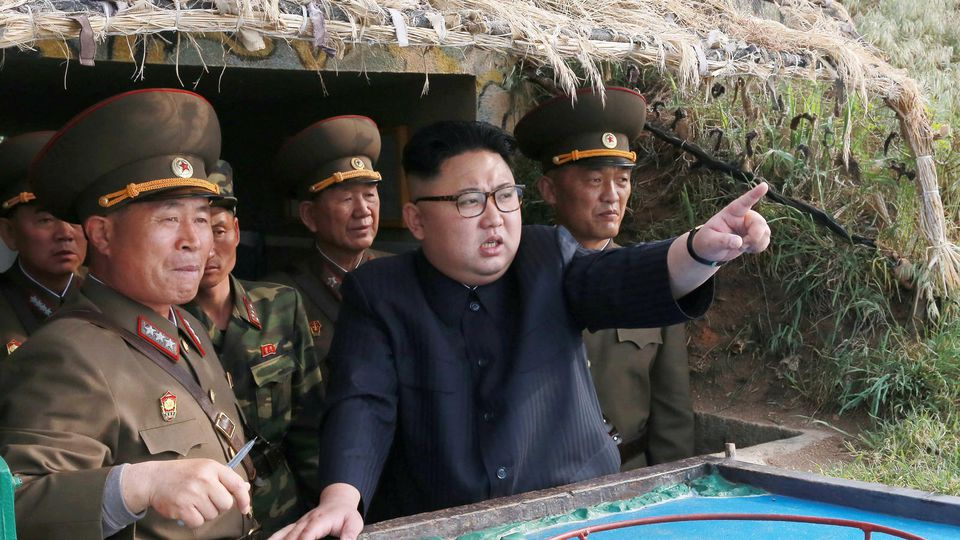 North Korean leader Kim Jong Un inspects the defence detachment on Jangjae Islet and the Hero Defence Detachment on Mu Islet located in the southernmost part of the waters off the southwest front, in this undated photo released by North Korea's Korea