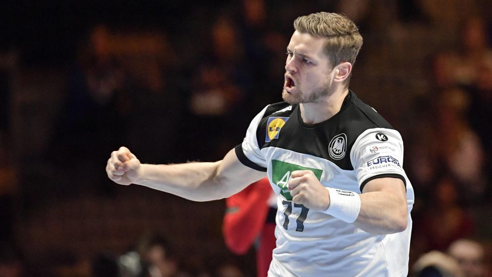 Germany s David Schmidt celebrates after scoring during the match for fifth/sixth place between Germany and Portugal du