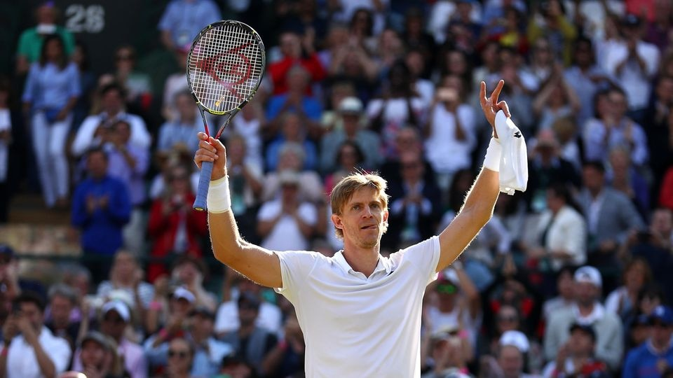 LONDON, ENGLAND - JULY 11:  Kevin Anderson of South Africa celebrates winning match point against Roger Federer of Switzerland during their Men's Singles Quarter-Finals match on day nine of the Wimbledon Lawn Tennis Championships at All England Lawn