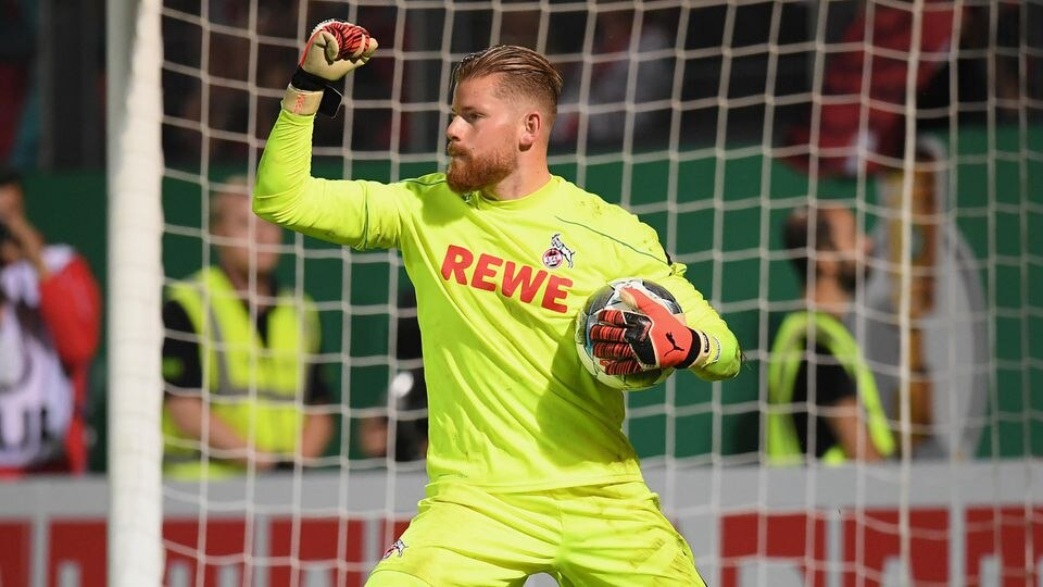 WIESBADEN, GERMANY - AUGUST 11: Goalkeeper Timo Horn of 1. FC Koeln celebrates during the penalty shoot-out during the DFB Cup first round match between SV Wehen Wiesbaden and 1. FC Koeln at BRITA-Arena on August 11, 2019 in Wiesbaden, Germany. (Phot