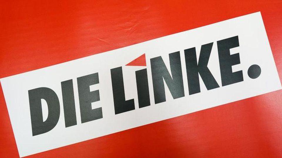 """Das Textlogo """"Die Linke."""". Foto: Peter Endig/zb/dpa/Archivbild"""