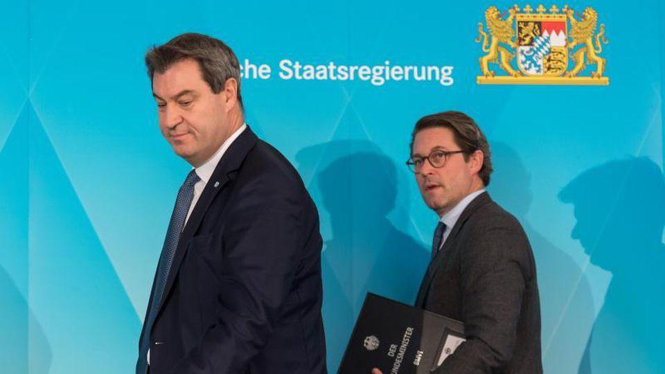 Markus Söder (l, CSU) und Andreas Scheuer (CSU) bei einem Termin. Foto: Peter Kneffel/dpa/Archivbild